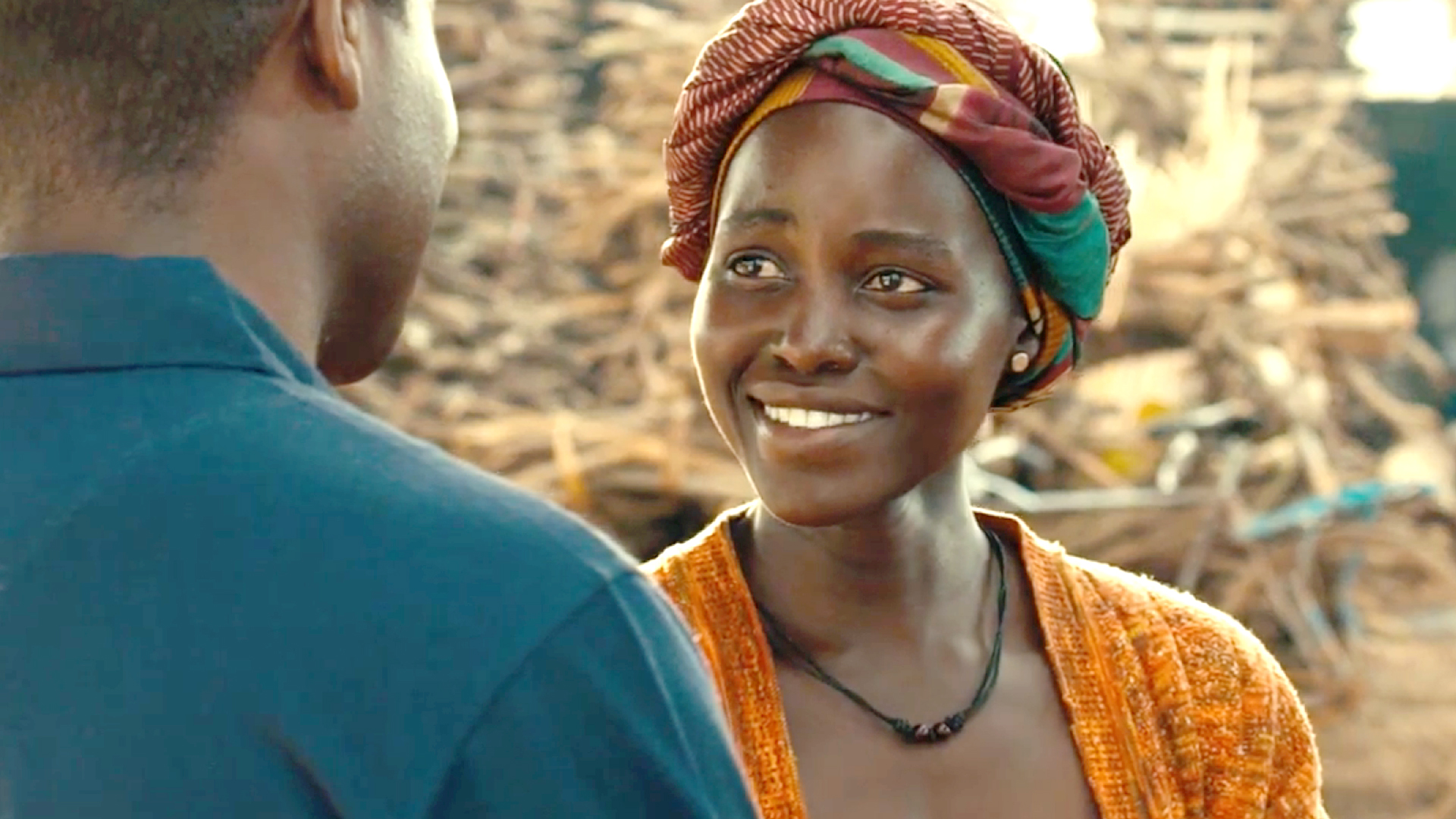 Film still from Queen of Katwe - Phiona smiles at her chess coach